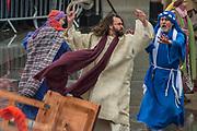 Jesus argues with teh priests in the temple - The Wintershall Players open-air re-enactment of 'The Passion of Jesus' on Good Friday in the rain in Trafalgar Square. It featured a cast of over 100 volunteers from in and around London.