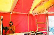 DJ cleaning record, Falougha, Lebanon, 2010