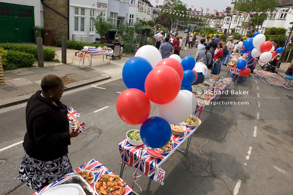 Neighbours and friends in Carver Road, Herne Hill south London, celebrate the royal wedding of Prince William and Kate Middleton (now called the Duke and Duchess of Cambridge). Across the UK, 5,500 formal road closures (825 in London) were arranged with local authorities and residents held traffic-free events, the like of which haven't been seen since the ill-fated wedding of Charles and Diana in 1981 - in the traditions of Victorian and end of war eras. .