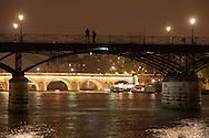 France. Paris. 1st district Art bridge on the Seine river at dusk view from the quai du Louvre/ le pont des arts sur la Seine