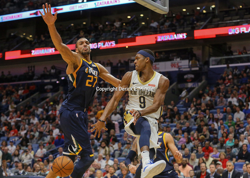 Mar 11, 2018; New Orleans, LA, USA; New Orleans Pelicans guard Rajon Rondo (9) passes the ball past Utah Jazz center Rudy Gobert (27) during the first half at the Smoothie King Center. Mandatory Credit: Derick E. Hingle-USA TODAY Sports