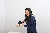 Portrait of beautiful young woman preparing to serve table tennis ball