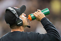NEW ORLEANS, LA - NOVEMBER 9:  Head Coach Jim Harbaugh of the San Francisco 49ers gets a drink of water on the sidelines during a game against the New Orleans Saints at Mercedes-Benz Superdome on November 9, 2014 in New Orleans, Louisiana.  (Photo by Wesley Hitt/Getty Images) *** Local Caption *** Jim Harbaugh