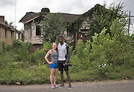 June 13, 2015, New Orleans, LA, Alan and Charlotte Akinkugbe in front of a blighted home in the lower Garden district, a couple houses down from a house they recently purchased for over 400K. <br /> Properties destroyed by Hurricane Katrina, remain scattered around New Orleans nearly ten years after the storm.
