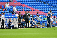 Football - 2019 / 2020 Championship - Cardiff City vs Charlton Athletic<br /> <br /> touchline official wearing mask , at the Cardiff City Stadium.<br /> <br /> COLORSPORT/WINSTON BYNORTH