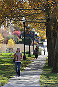 A student walks to class on the Lincoln Street side of Franklin Hall.