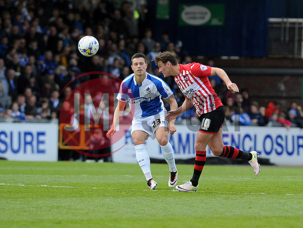 Lee Holmes of Exeter City heads clear from Billy Bodin of Bristol Rovers - Mandatory by-line: Neil Brookman/JMP - 23/04/2016 - FOOTBALL - Memorial Stadium - Bristol, England - Bristol Rovers v Exeter City - Sky Bet League Two
