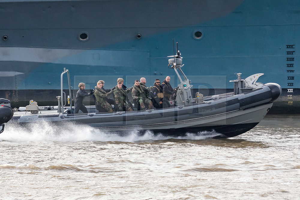 © Licensed to London News Pictures. 23/10/2018. London, UK. Dutch Royal Netherlands Marines in a RIB alongside HMS Belfast during a rehearsal for a display tomorrow when the Royal Marines and Royal Netherlands Marines will stage a joint on water capability demonstration with blank ammunition. As part of the Dutch state visit, King Willem-Alexander and Queen Máxima will attend the Dutch ship HNLMS Zeeland, which is anchored next to HMS Belfast. They will join The Duke of Kent on board and will be given a 10 minute display of the Royal Marines and Royal Netherlands Marines staging a joint on water capability demonstration.Photo credit: Vickie Flores/LNP