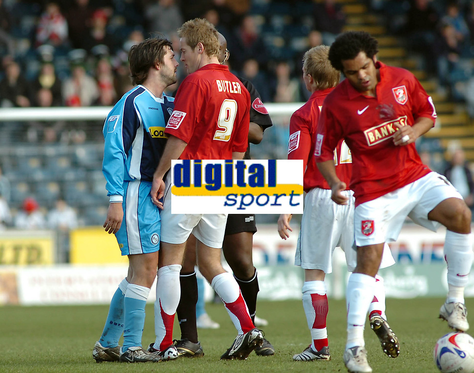 Photo: Kevin Poolman.<br />Wycombe Wanderers v Walsall. Coca Cola League 2. 17/03/2007. Tommy Doherty of Wycombe (left) goes head to head with Martin Butler of Walsall.