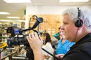 William Wayne Webb, Jr. documents the FedEx volunteer efforts at Habitat For Humanity in Milpitas, Calif., on Sept. 11, 2012.  Photo by Stan Olszewski/SOSKIphoto.