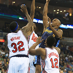 28 January 2009:  Denver Nuggets guard Chauncey Billups (7) shoots over a host of Hornets players during a 94-81 win by the New Orleans Hornets over the Denver Nuggets at the New Orleans Arena in New Orleans, LA. The Hornets wore special throwback uniforms of the former ABA franchise the New Orleans Buccaneers for the game as they honored the Bucs franchise as a part of the NBA's Hardwood Classics series. .