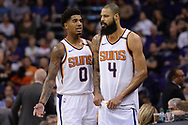 Oct 25, 2017; Phoenix, AZ, USA; Phoenix Suns forward Marquese Chriss (0) and center Tyson Chandler (4) talk on the court in the game against the Utah Jazz in the first half at Talking Stick Resort Arena. Mandatory Credit: Jennifer Stewart-USA TODAY Sports