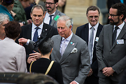 © Licensed to London News Pictures . 14/05/2015 . Liverpool , UK . The Prince of Wales talks to the Mayor and Deputy Mayor outside as he leaves a visit with the Duchess of Cornwall to the World Museum in Liverpool . Photo credit : Joel Goodman/LNP