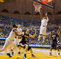 West Virginia Mountaineers guard Jevon Carter (2) shoots a layup against the Wofford terriers during the first half at the WVU Coliseum.