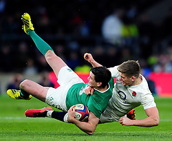 Jonathan Sexton of Ireland is tackled by Owen Farrell of England - Mandatory byline: Patrick Khachfe/JMP - 07966 386802 - 27/02/2016 - RUGBY UNION - Twickenham Stadium - London, England - England v Ireland - RBS Six Nations.