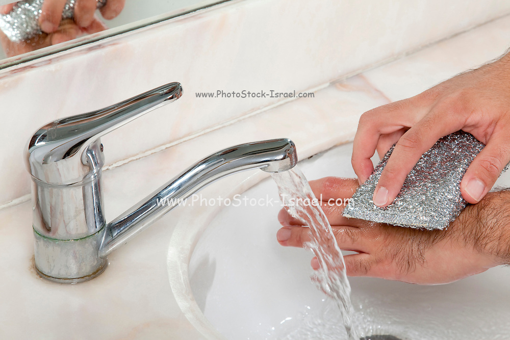 Personal hygiene - scrubbing hands to reduce the risk of infecting others with swine flue and other diseases