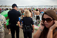Officers from the San Diego Police Department kept watch during the Floatopia event in Mission Bay near Fanuel Street Park, March 20, 2010. Roughly 5,000 people took to the water to skirt an alcohol ban on San Diego's beaches.