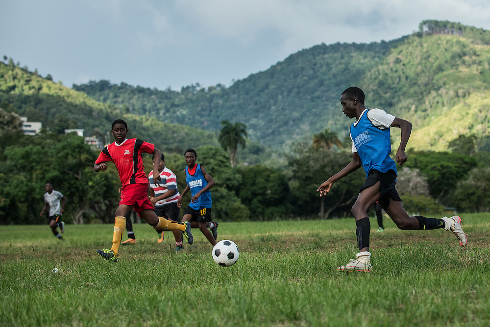 PORT OF SPAIN, TRINIDAD - FEBRUARY 13, 2017: Teens play soccer in the sprawling Queen's Park Savannah, in the heart of the city, on the park's green lawns.  PHOTO: Meridith Kohut for The New York Times