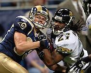 Jacksonville Jaguars defensive back Rashean Mathis (R) takes the ball away from St. Louis Rams wide receiver Kevin Curtis (L) for an interception in the first quarter at the Edward Jones Dome in St. Louis, Missouri, October 30, 2005.  The Rams beat the Jaguars 24-21.