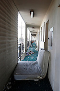 The hallway of the abandoned Economy Inn is empty during the day, but come nightfall many people return to rooms they have claimed as their own in New Orleans on April 12, 2007.