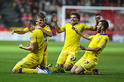 Leeds players celebrate with goal scorer Chris Wood during the Sky Bet Championship match between Bristol City and Leeds United at Ashton Gate, Bristol, England on 19 August 2015. Photo by Shane Healey.