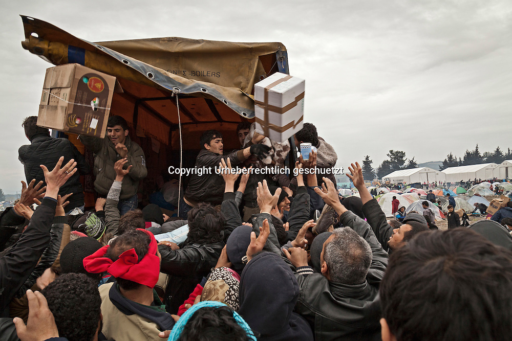 Greece, Idomeni, Refugees on their way to Europe,   <br /> <br /> An auxiliary supply looted by the refugees.<br /> Refugees from Syria, Irak, Afghanistan and others from the near east are stucked at the border between FYROM (Macedonia) Idomeni, is the eye of a needle for getting to nothern Europe. <br /> The FYROM ( Macedonia) authorities, closed the border from Greece completely. The situation close to the border gets more and more difficult. There is not enough food and supplies to help about 12.000 refugees<br /> <br /> Eine Hilfslieferung wird von Fluechtlingen gepluendert.<br /> Nadeloehr nach Nordeuropa Idomeni, der Grenzuebergang ist seit Tagen gesperrt.  Im provisorischen Fluechtlingslager in Idomeni stecken tausend Fluechtlinge fest.<br /> <br /> <br /> <br /> keine Veroeffentlichung unter 50 Euro*** Bitte auf moegliche weitere Vermerke achten***Maximale Online-Nutzungsdauer: 12 Monate !! <br /> <br /> for international use:<br /> Murat Tueremis<br /> C O M M E R Z  B A N K   A G , C o l o g n e ,  G e r m a n y<br /> IBAN: DE 04 370 800 40 033 99 679 00<br /> SWIFT-BIC: COBADEFFXXX