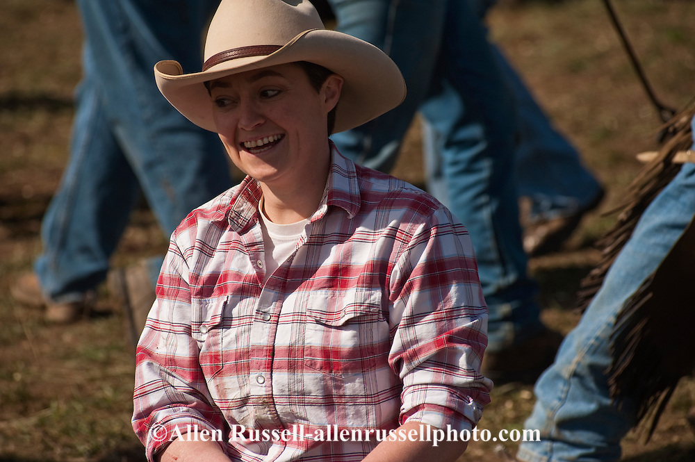 Cowgirl, Shyla Adamson works at branding, Wilsall, Montana,<br />