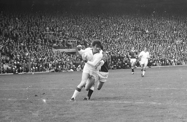 Cork runs with the ball followed close by Galway during the All Ireland Senior Gaelic Football Championship Final Cork v Galway in Croke Park on the 23rd September 1973. Cork 3-17 Galway 2-13.