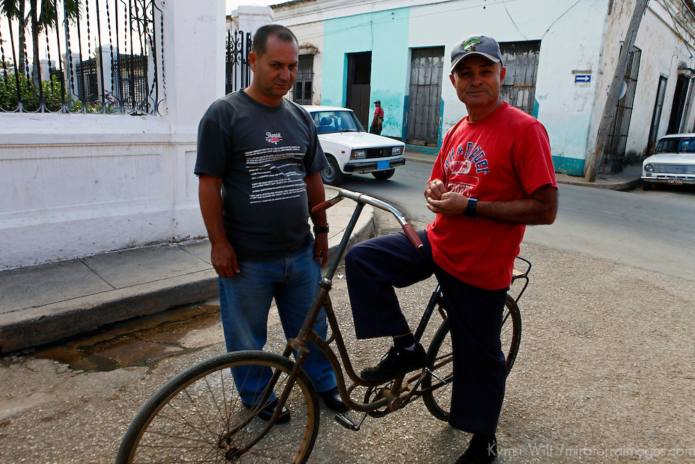 Central America, Cuba, Remedios. Cuban men and an unusual bike in Remedios.