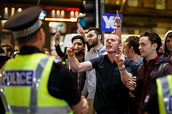 © Licensed to London News Pictures. 19/09/2014. Glasgow, UK. Scottish independence supporters posing against pro-Unionists at George Square in Glasgow as Scotland decides to stay in the union and First Minister Alex Salmond resigns over the results of the Scottish independence referendum on Friday, 19 September 2014. Photo credit : Tolga Akmen/LNP