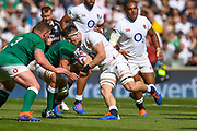 England player Tom Currytrys to break through an Irish tackle in the first half during the England vs Ireland warm up fixture at Twickenham, Richmond, United Kingdom on 24 August 2019.