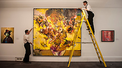 "© Licensed to London News Pictures. 28/01/2016. London, UK.   Technicians install ""The Sunflowers"" by Adrien Ghenie (est. £0.4-0.6m), on display at Sotheby's preview of its upcoming Impressionist, Modern & Surrealist art sale on 3 February featuring works by some of the most important artists of the 20th century.  The combined total of the evening sale is expected to exceed £100m. Photo credit : Stephen Chung/LNP"