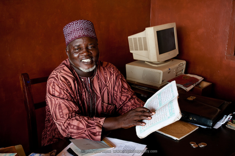 Mohammed Mustapha Yadjalal founded a school in his Nima home in 1984. In 1986, when it reached the point that he had 400 students in his home, the school moved to its present site, and was later taken over by the Islamic Education Unit of the Ghana Education Service. Students learn Arabic and Islamic studies from 8:00 - 10:00am, and then a conventional English curriculum from 10:00am - 3:00pm. He is pictured in his office at the school.