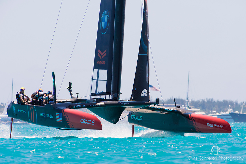 The Great Sound, Bermuda, 18th June. Oraacle Team USA finish behind Emirates Team New Zealand in race three on day two of the America's Cup.