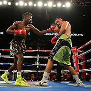 "Welterweight fighter Erickson ""Hammer"" Lubin (left) fights against Noe Bolanos during the ""Judgement Day"" boxing event at American Airlines Arena on Thursday, July 10, 2014 in Miami, Florida.  (AP Photo/Alex Menendez)"