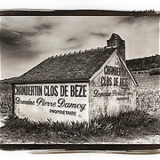 GEVREY-CHAMBERTIN, FRANCE - APRIL 22, 2018: A small farm building sits in the middle of the Burgundy grand cru vineyard of Clos de Beze near the town of Gevrey-Chambertin in the Cote de Nuits region.