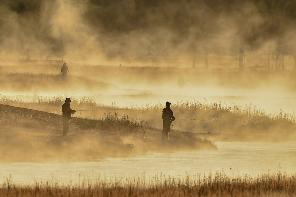Fishermen in early morning golden light, Yellowstone
