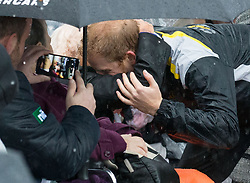 Prince Harry embraces Daphne Dunne, 97, on a walkabout on Circular Quay in Sydney, Australia, during a day of events to mark the official launch of the Invictus Games Sydney 2018.