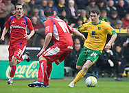 Norwich City - Saturday May 8 2010: of Norwich City's Wes Hoolahan on the ball against Carlisle's Ian Harte during match at Carrow Road, Norwich. (Pic by Rob Colman Focus Images)