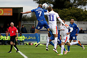 AFC Wimbledon midfielder Scott Wagstaff (7) battles for possession with Luton Town midfielder Andrew Shinnie (11) during the EFL Sky Bet League 1 match between AFC Wimbledon and Luton Town at the Cherry Red Records Stadium, Kingston, England on 27 October 2018.