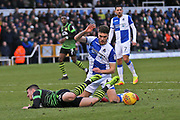 Bristol Rovers Ryan Sweeney (6) brings down   Doncaster Rovers Tommy Rowe (10) in the box during the EFL Sky Bet League 1 match between Bristol Rovers and Doncaster Rovers at the Memorial Stadium, Bristol, England on 23 December 2017. Photo by Gary Learmonth.