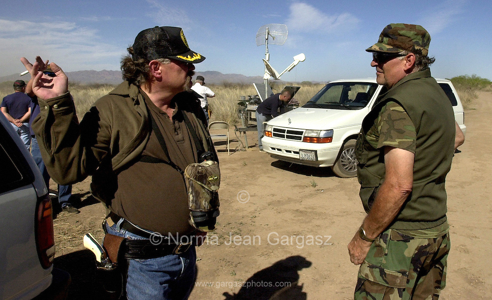 Members of the American Border Patrol, a civilian border watch group, use technology to monitor illegal immigration along the United States and Mexico Border near Palominas, Arizona.