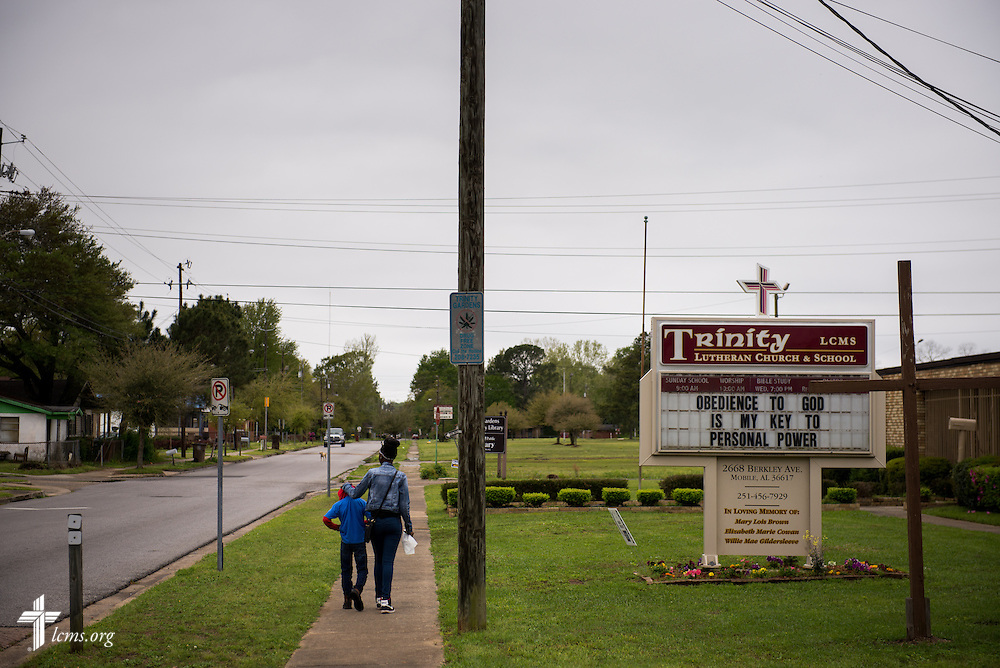 Two children walk past Trinity Lutheran Church on Sunday, April 6, 2014, in Mobile, Ala. LCMS Communications/Erik M. Lunsford