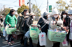© under license to London News Pictures.  19/03/2011. People queuing to purchase essential items outside a shopping mall in Tagajo, a suburb of Sendai, Japan today (19/03/2011). Photo credit should read London News Pictures.