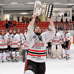 FORT FRANCES, ON - May 2, 2015 : Central Canadian Junior &quot;A&quot; Championship, game action between the Fort Frances Lakers and the Soo Thunderbirds, Championship game of the Dudley Hewitt Cup. David Radke #24 of the Soo Thunderbirds raises the Dudley Hewitt Cup.<br /> (Photo by Shawn Muir / OJHL Images)