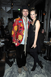 SAVANNAH MILLER and her husband NICK SKINNER at a party for Yves Saint Laurent's Creative Director Stefano Pilati given by Colin McDowell held at The Connaught Bar, The Connaught, Mount Street, London on 29th October 2008.