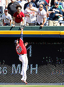 ATLANTA - OCTOBER 3:  Outfielder Jason Heyward #22 of the Atlanta Braves catches a fly ball against the wall during the game against the Philadelphia Phillies at Turner Field on October 3, 2010 in Atlanta, Georgia.  The Braves beat the Phillies 8-7.  (Photo by Mike Zarrilli/Getty Images)