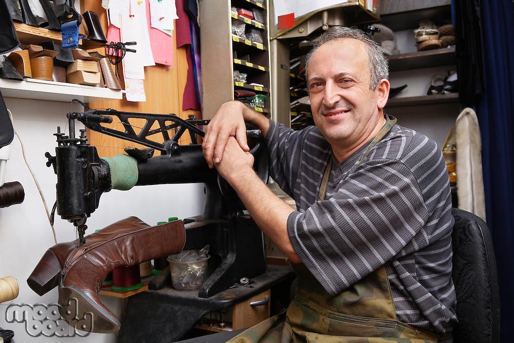 Shoemaker Repairing Boot in Shoe Shop