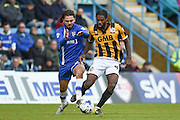 Gillingham midfielder Bradley Dack and Port Vale midfielder Anthony Grant during the Sky Bet League 1 match between Gillingham and Port Vale at the MEMS Priestfield Stadium, Gillingham, England on 16 April 2016. Photo by Martin Cole.