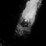 Divers diving on the Great Barrier Reef. Divers in a cave.